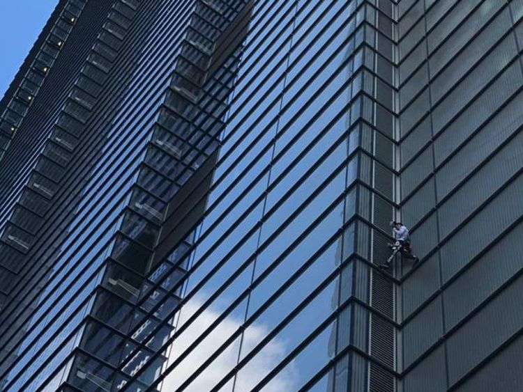 Alain Robert scaling the Heron Tower