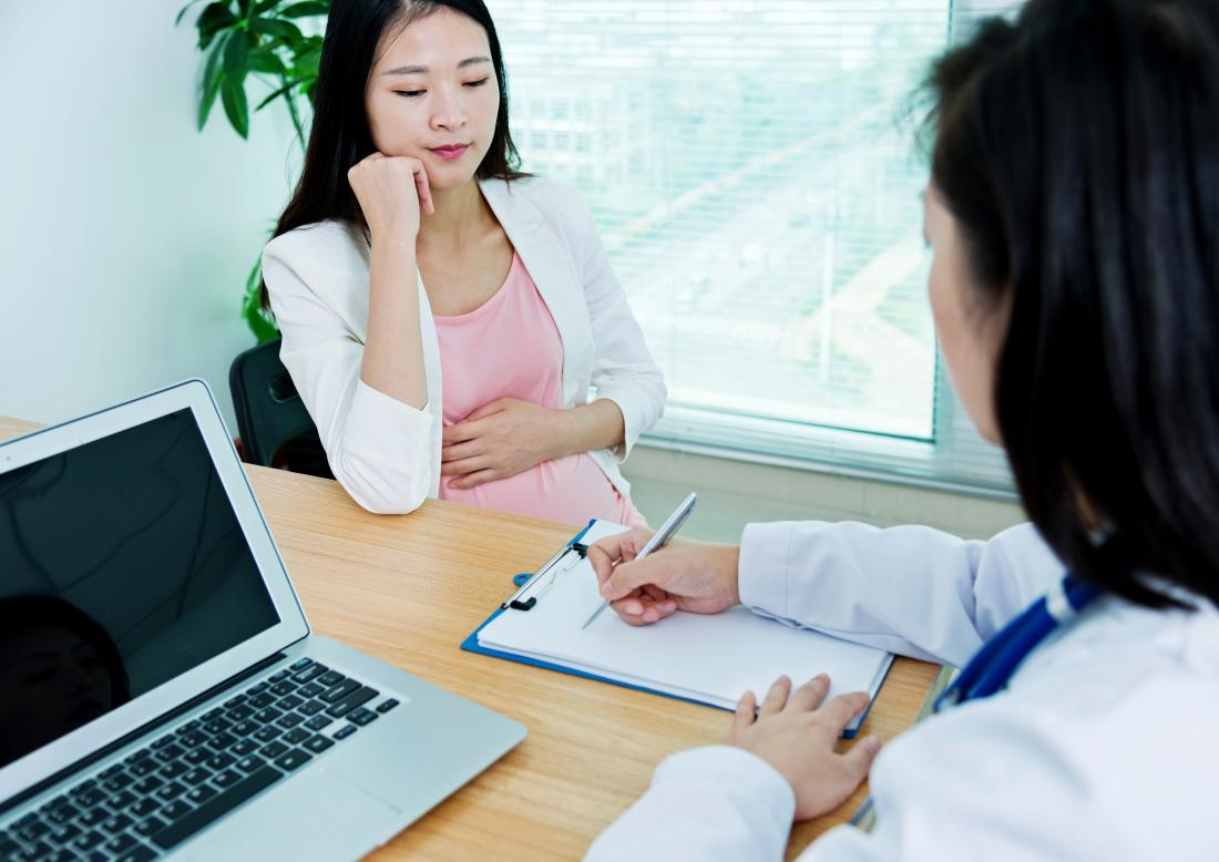 Pregnant lady visiting with a GP