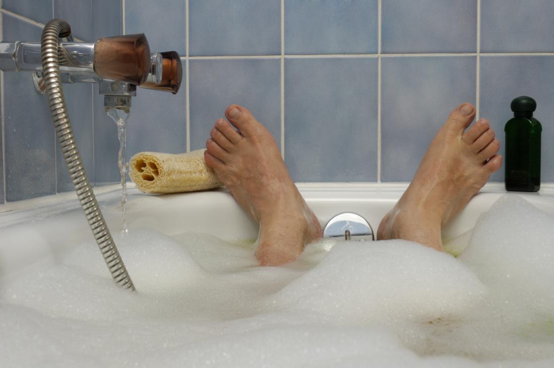 Mans feet at the end of a bath