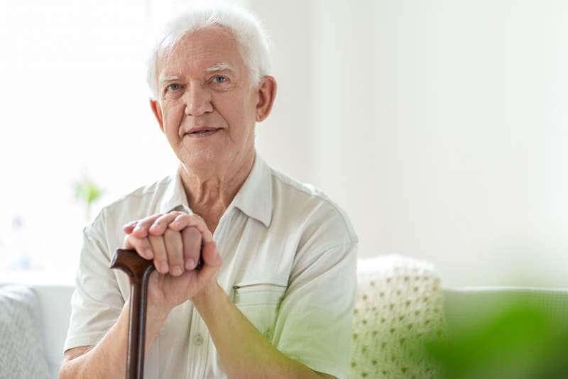 elderly-man-with-wooden-walking-stick