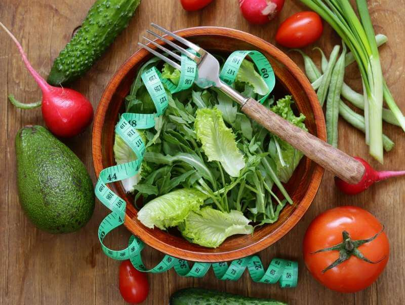green-salad-with-measuring-tape