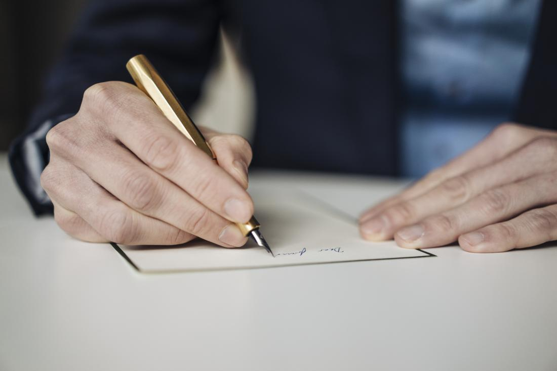 Person writing by hand.