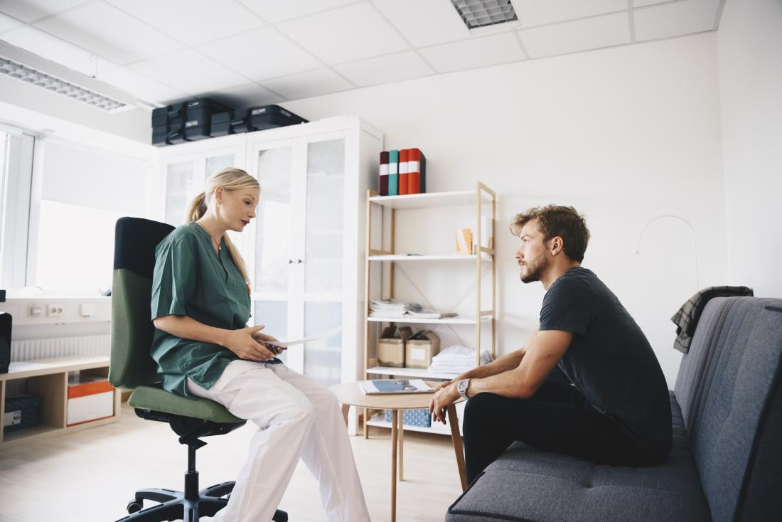 doctor speaking to patient in modern office
