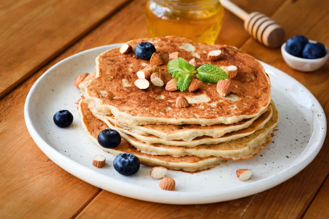 Gluten-free pancakes for different diets topped with blueberries and nuts