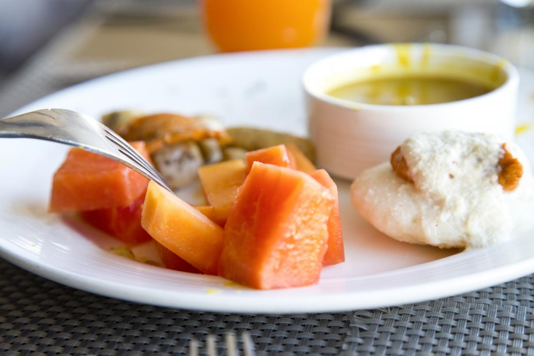 Indian diet breakfast option on a plate including idli and fruit.
